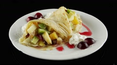 Dessert, pancakes with fresh fruits and whipped cream, loop, horizontal view Stock Footage