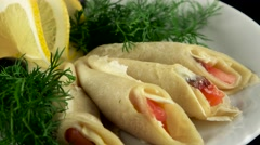 Pancakes with smoked salmon and butter, loop - stock footage