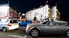 LONDON – MAY 22, 2015: Traffic in Piccadilly Circus at night. London attracts 30 - stock footage