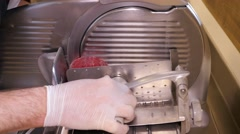 Meat cutting and slicing machine, making carpaccio, closeup Stock Footage