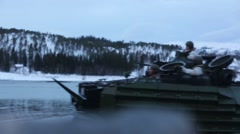 NAMSOS NORWA, MARCH 2016, Close Up US Amphibious Vehicle Land Snowy Beach Stock Footage