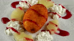 Sweet dessert with marmalade, pineapple and whipped cream, loop Stock Footage