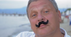 Senior man with fake mustache - stock footage