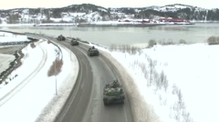 NORWAY, MARCH 2016, US Tanks Drive Street Winter Time Filmed Air Stock Footage