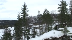 NORWAY, MARCH 2016, Vertical Overflight US Soldier Snowy Area Stock Footage
