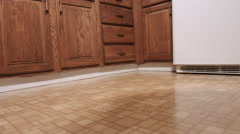 Panning Low Angle of Old Kitchen Cabinets - stock footage