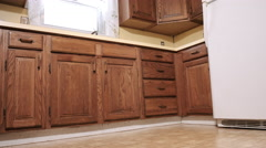 Low Angle Move In and Out Wide Shot of Old Yellow Kitchen Corner - stock footage