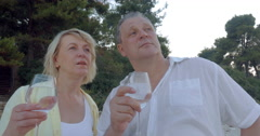 Man and Woman Having Drink and Talk Outdoor Stock Footage
