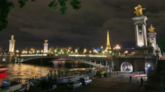 Stunning night view Paris city and Pont Alexandre III Stock Footage