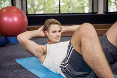 Man doing abdominal crunches - stock photo
