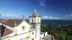 Flying over Se Cathedral in Olinda and the beautiful coast in Recife, Brazil Stock Footage