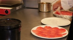 Dressing up a delicious carpaccio salad in a restaurant kitchen, close up - stock footage