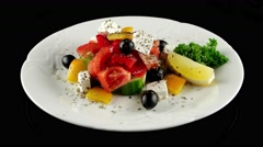 Organic salad with fresh vegetables and feta cheese, loop, horizontal view - stock footage