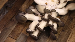 Mushrooms on brown wooden table. Stock Footage