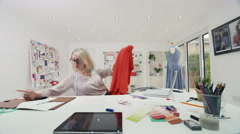 4K Time lapse of busy fashion designer at work in her studio Stock Footage