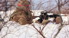 Stock Video Footage of NORWAY, MARCH 2016, Close Up Nato Soldier Defense Position Winter Time