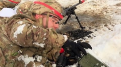 NORWAY, MARCH 2016, Nato Soldier Open Munition Case Another Fires Machine Gun - stock footage