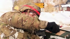 NORWAY, MARCH 2016, Nato Soldier Take Munition Case Another Fires Machine Gun - stock footage