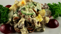 Meat salad with fresh orange, avocado and mayonnaise, loop - stock footage