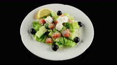 Salad with salmon and feta cheese, loop, top view - stock footage