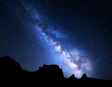 Mountain landscape with Milky Way. Night sky with stars - stock photo