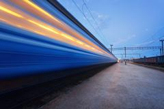 High speed passenger train on tracks in motion. Railway station Kuvituskuvat