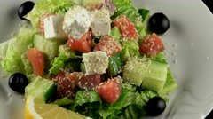 Fresh Norwegian salad with salmon and feta cheese, loop - stock footage