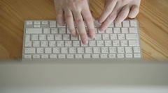 Top View of Business Workspace with Hands Typing on Computer - stock footage