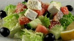 Fresh salad with salmon and feta cheese, loop - stock footage
