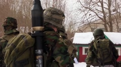 NORWAY, MARCH 2016, Nato Soldiers Winter Training Stay In Front House Stock Footage