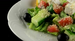 Fresh organic salad with salmon and feta cheese, loop - stock footage