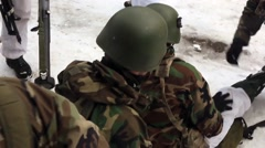 NORWAY, MARCH 2016, Nato Soldiers Help Injured Soldier At Winter Training Stock Footage