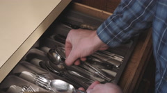 Above Grab Silverware Utensils and Put Away - stock footage