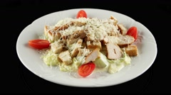 Grilled chicken Caesar salad with Parmesan cheese, loop, horizontal view - stock footage