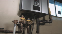 Push In and Back on Low Angle Closeup of Tankless Water Heater Stock Footage