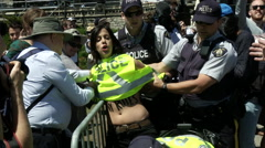 Police arresting nude protestors from Femen on Parliament Hill - stock footage