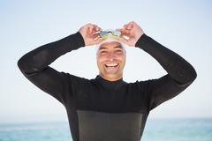 Portrait of smiling fit swimmer on the beach Stock Photos
