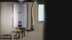 Reveal Tankless Water Heater From Behind Wall Stock Footage