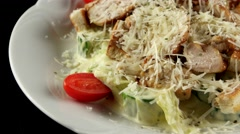 Caesar salad with grilled chicken, loop Stock Footage