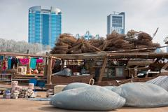 Abu Dhabi buildings skyline with old fishing boats Kuvituskuvat