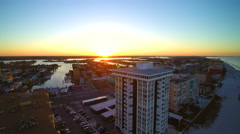 Slow descent of sunrise and condos in Florida Stock Footage