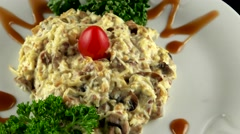 Beef salad with grated celery root, fried mushrooms and mayonnaise, loop - stock footage