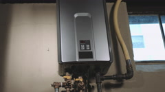 Panning Right Closeup of Tankless Water Heater in Basement Stock Footage