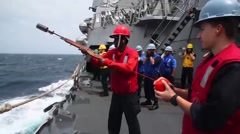 USA USS Chung-Hoo, March 2016, Soldier Fires Line Support Ship Stock Footage
