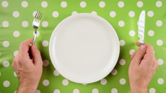 Top view of nervous hungry male hands at dinner table - stock footage