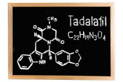 Blackboard with the chemical formula of Tadalafil Stock Illustration