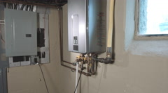 Tankless Water Heater Side Push In and Back Stock Footage