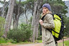 Woman with backpack in the countryside Stock Photos