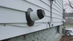 Wide Panning Water Heater Vent Side of House Stock Footage