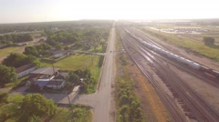 Pan from Car Driving Down Road To Train & Oil Storage Aerial Houston Stock Footage